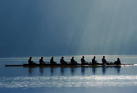 Competitive rowers in a boat