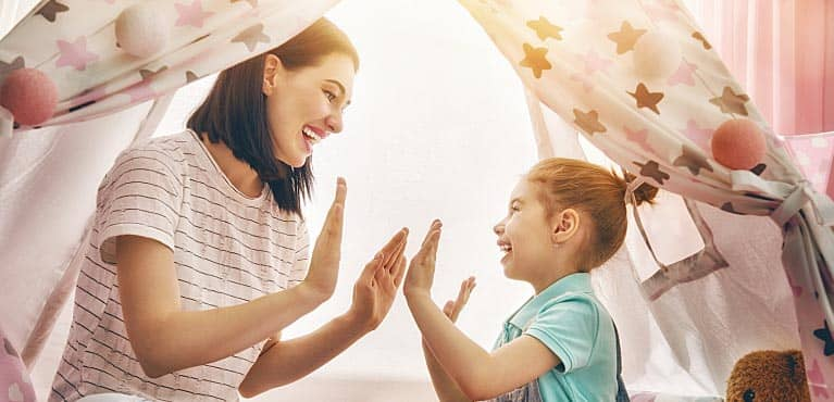 A mother plays a game with her young daughter: term life insurance