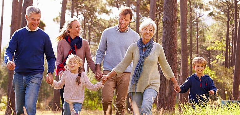 multigenerational family enjoys a walk on a sunny fall day retirement mistakes