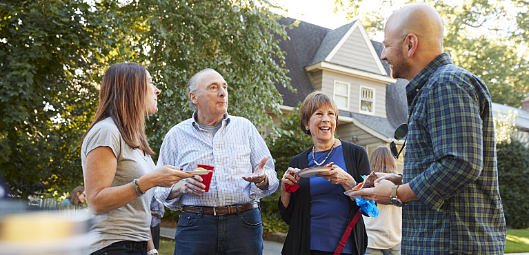 Neighbors talking at block party