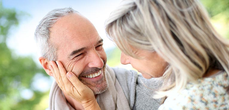 Smiling senior couple: medicare supplement insurance