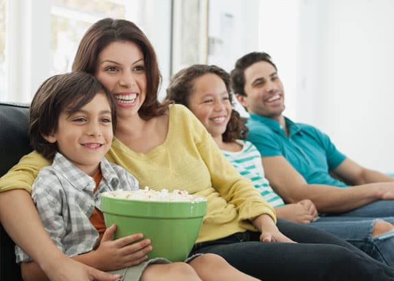 clic indexed universal life family eating popcorn