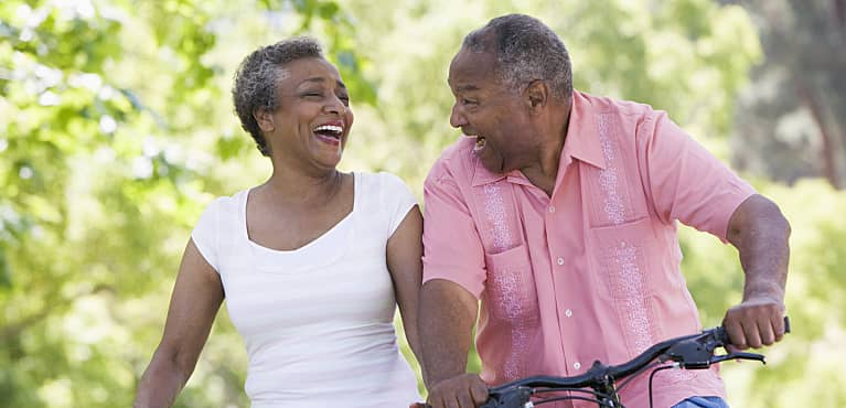 Older couple laughing outdoors