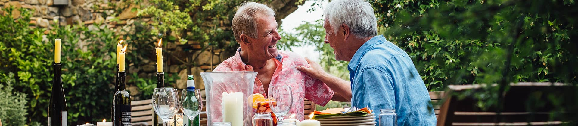 two men laughing at dinner party