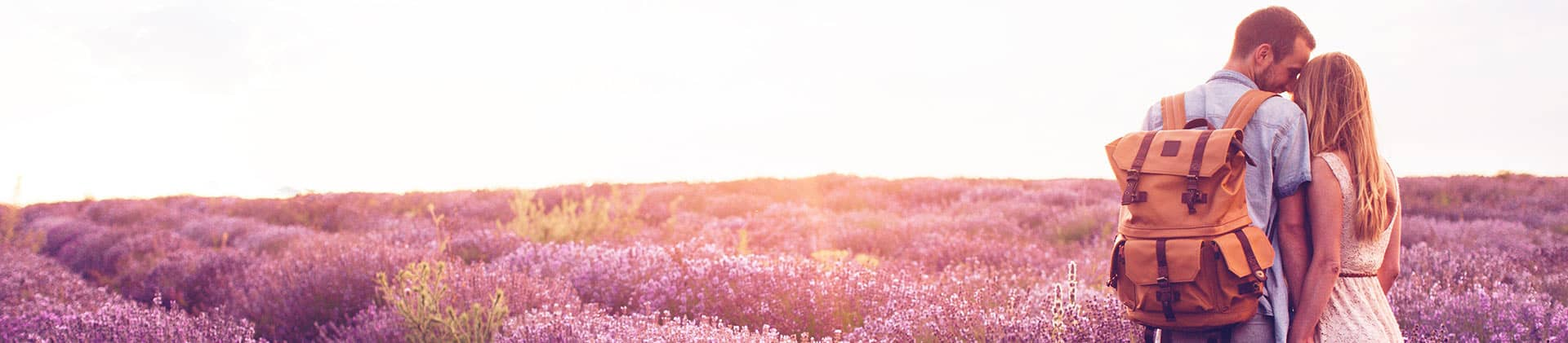 young couple in lavender field discussing annuichoice annuity