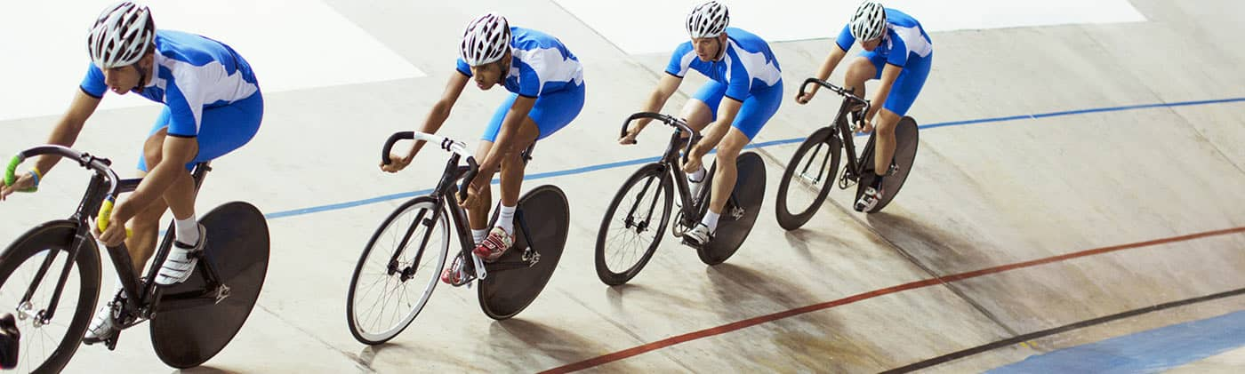 Cyclists in velodrome racing