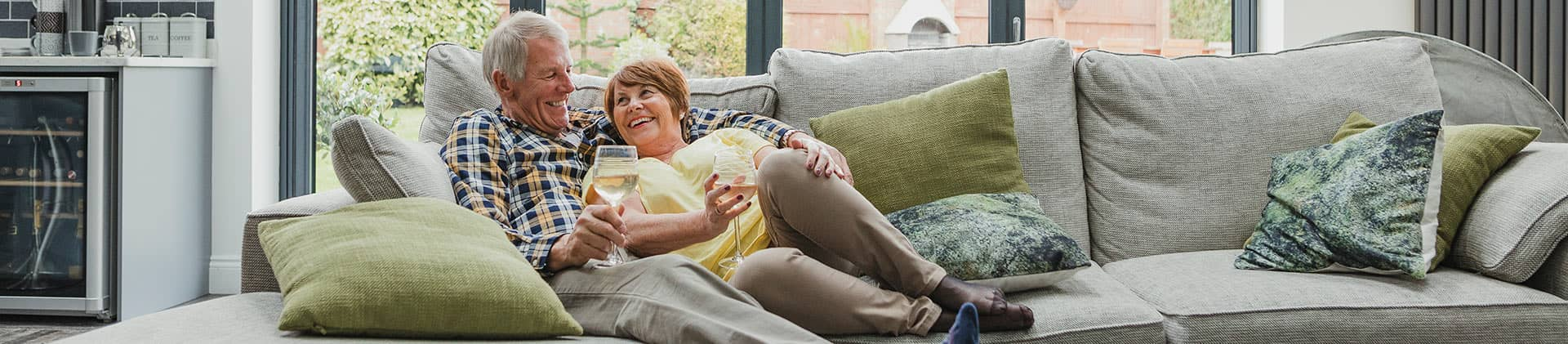 retired couple relaxing on the couch together
