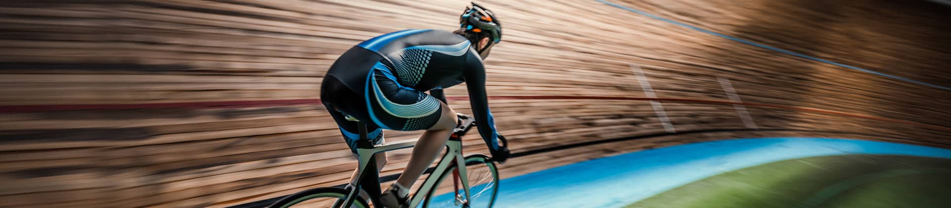 Cyclist in velodrome racing