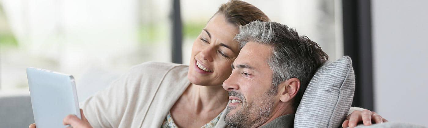 middle-aged couple prepares their retirement budget and asks: how much to do I need to retire at 50?