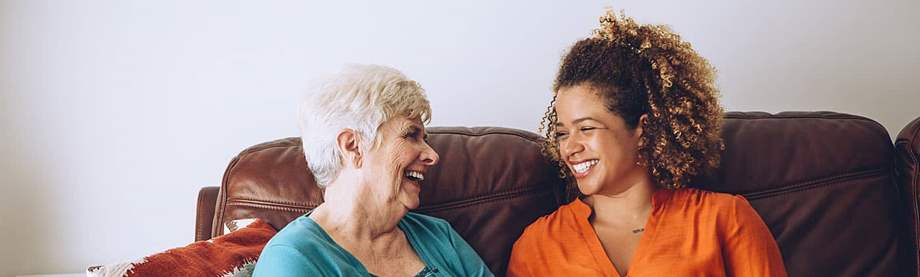 An elderly woman talking to her granddaughter about disability and retirement benefits
