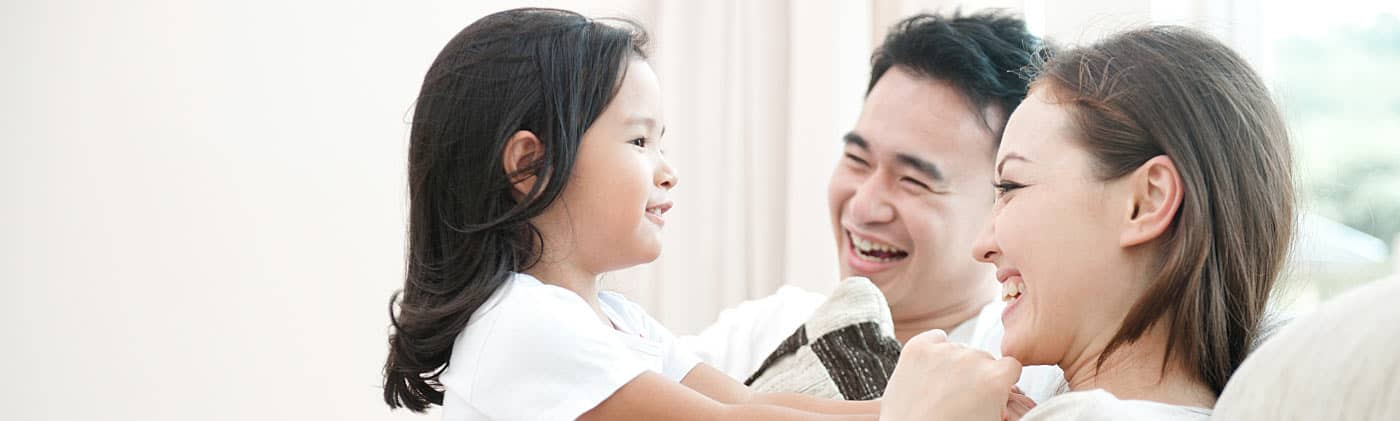 Asian parents and young daughter playing and talking about life insurance myths