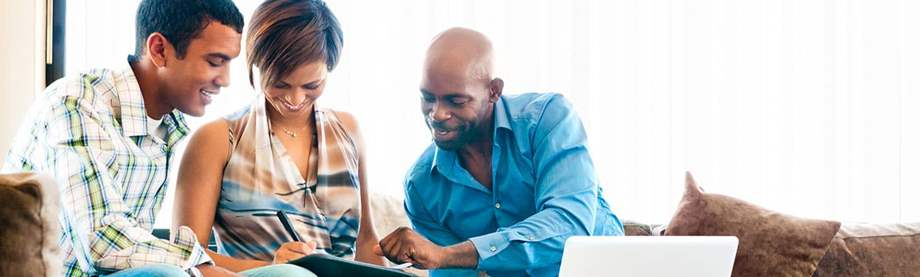 Financial Professional getting information from a young couple