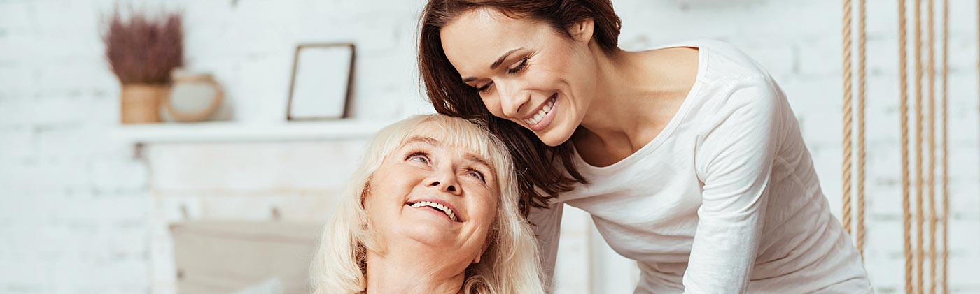 A woman cares for her aging mother at home: caregiver