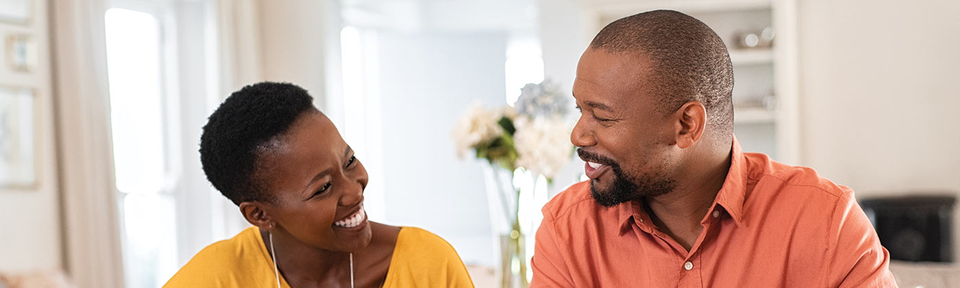 Couple discussing finances how tackle credit card debt greater financial health