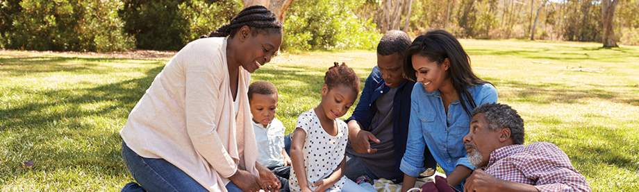 family having picnic discussing life insurance