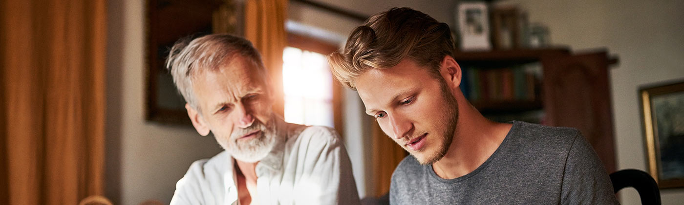 Father son helping protect parents from elder financial abuse and fraud