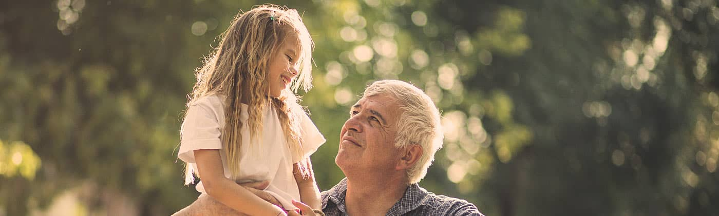 Girl hugging her grandfather after discussing what happens to annuities when you die