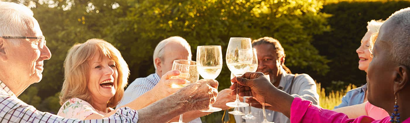 Group of coworkers toasting a recent retiree after planning retirement party ideas