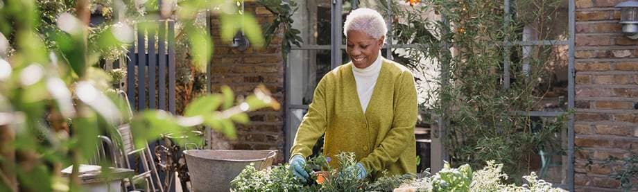 happy older woman gardening after researching power of attorney