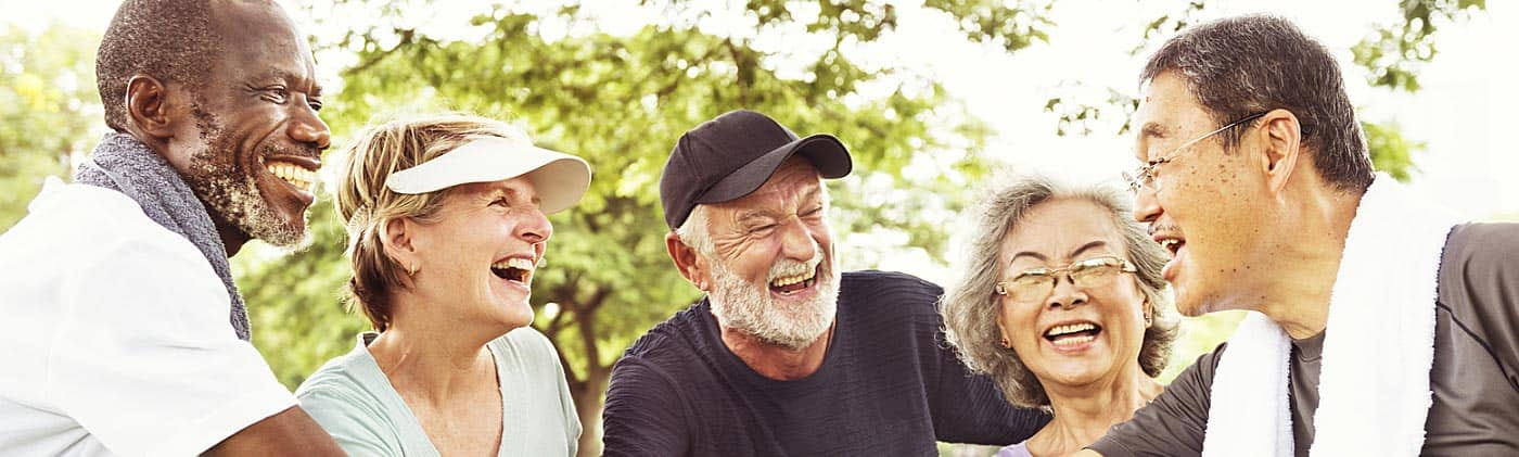 happy senior couples laugh together in the park and are thinking about how to plan for retirement