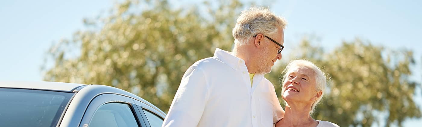 happy retired couple uses required minimum distribution from their ira to take a fun road trip