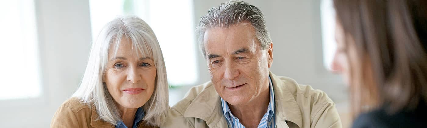 Husband and wife meeting to discuss downsizing your home for retirement