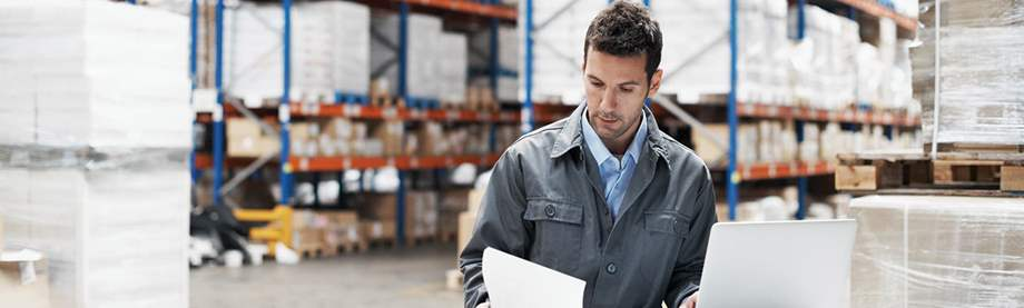man working in warehouse thinking about how help protect your business against loss of key employee