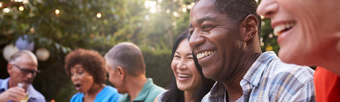 friends celebrate life after retirement at backyard party and discuss how to stretch your savings