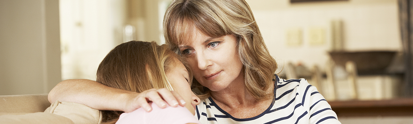 Mother comforts young daughter at home: financial planning checklist