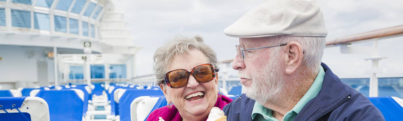 old couple eating ice cream on a cruise and wondering if retiring on a cruise ship is right for you