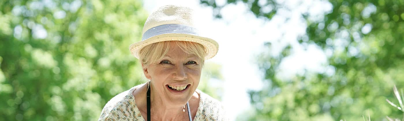 Older woman gardening after appointing power of attorney