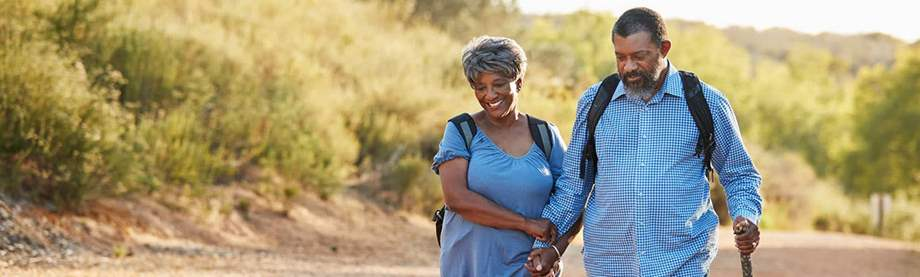 Retired couple hiking on a trial