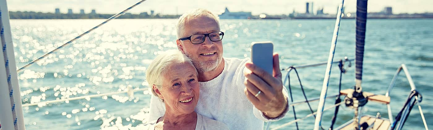 Retired couple taking a picture on a boat after they retired overseas