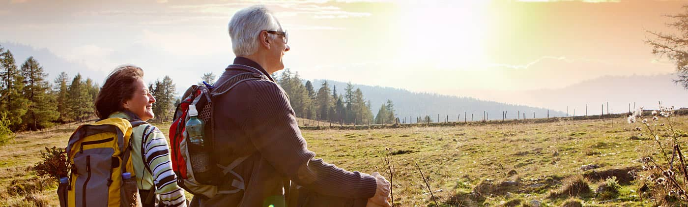 Retirees who receive an immediate annuity taking a break from hiking