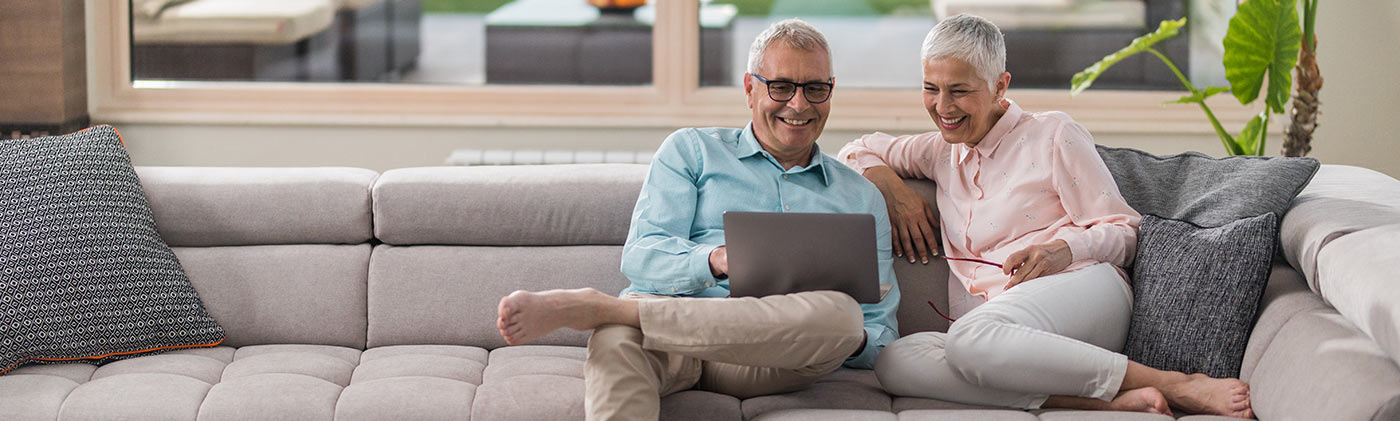 senior couple at home reviewing finances and deciding how long their retirement savings will last