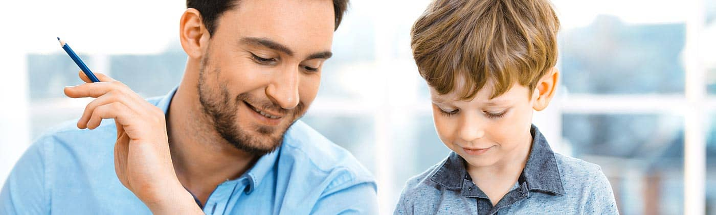 Single father doing his budget and spending time with his young son: divorce finances