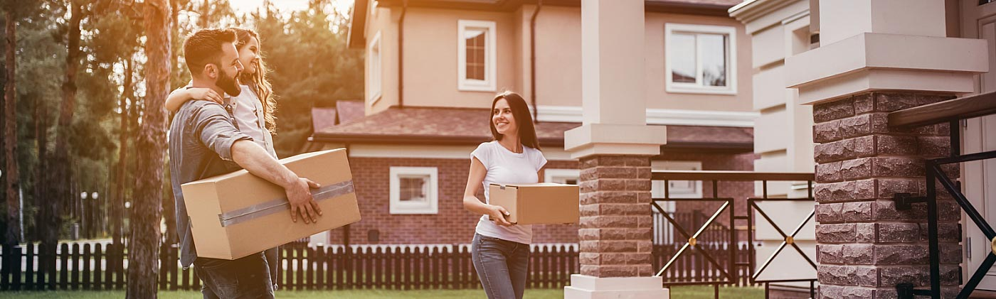 Smiling couple with their child moving into a new house: student loan debt and buying a house
