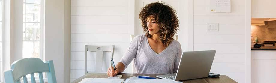 Tax Season Woman Organizing Paperwork Working Online