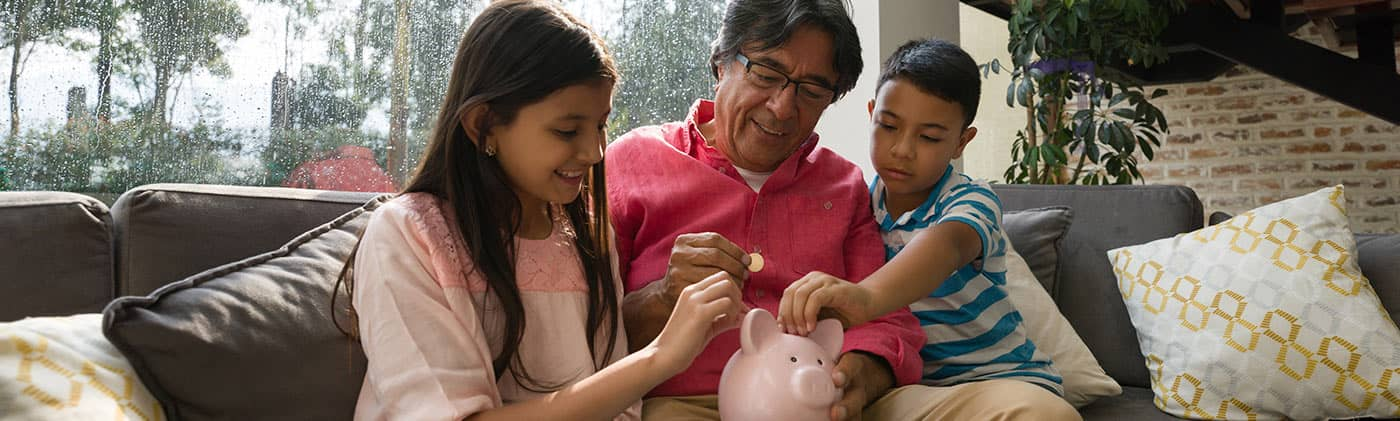 Grandfather teaching children financial literacy