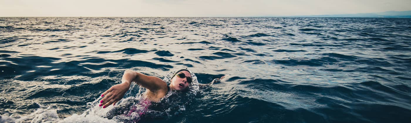 open water swimmer swimming in sea image