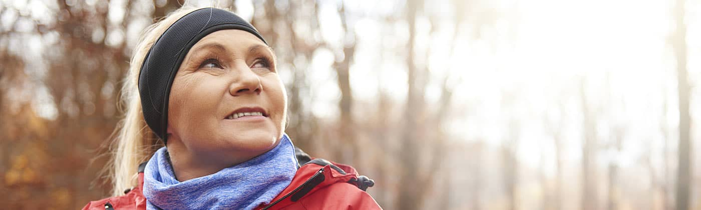 Woman zipping up coat on a run and thinking about how annuities work