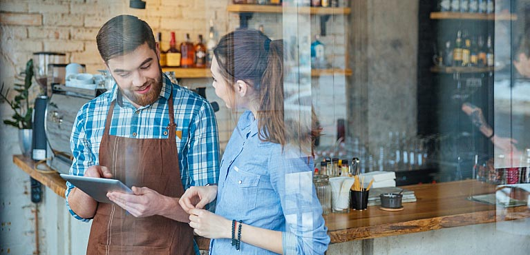 Business owner speaks with an employee in his shop: asset protection strategies