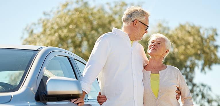 Happy retired couple able to take a fun road trip thanks to a planned required minimum distribution