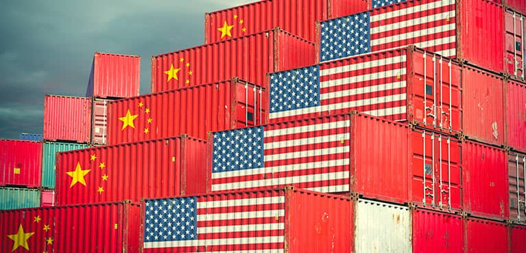 Shipping containers with US and China flags