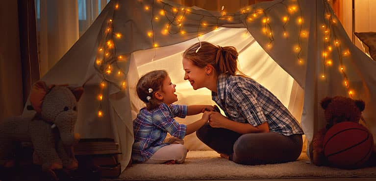 Woman and daughter in a tent: difference between whole life insurance and universal life insurance