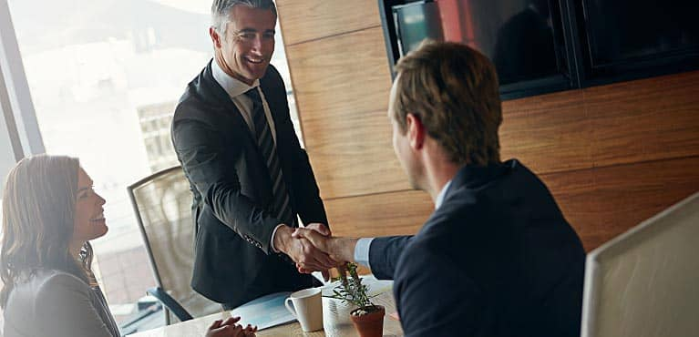 Two business professionals agreeing on a deal